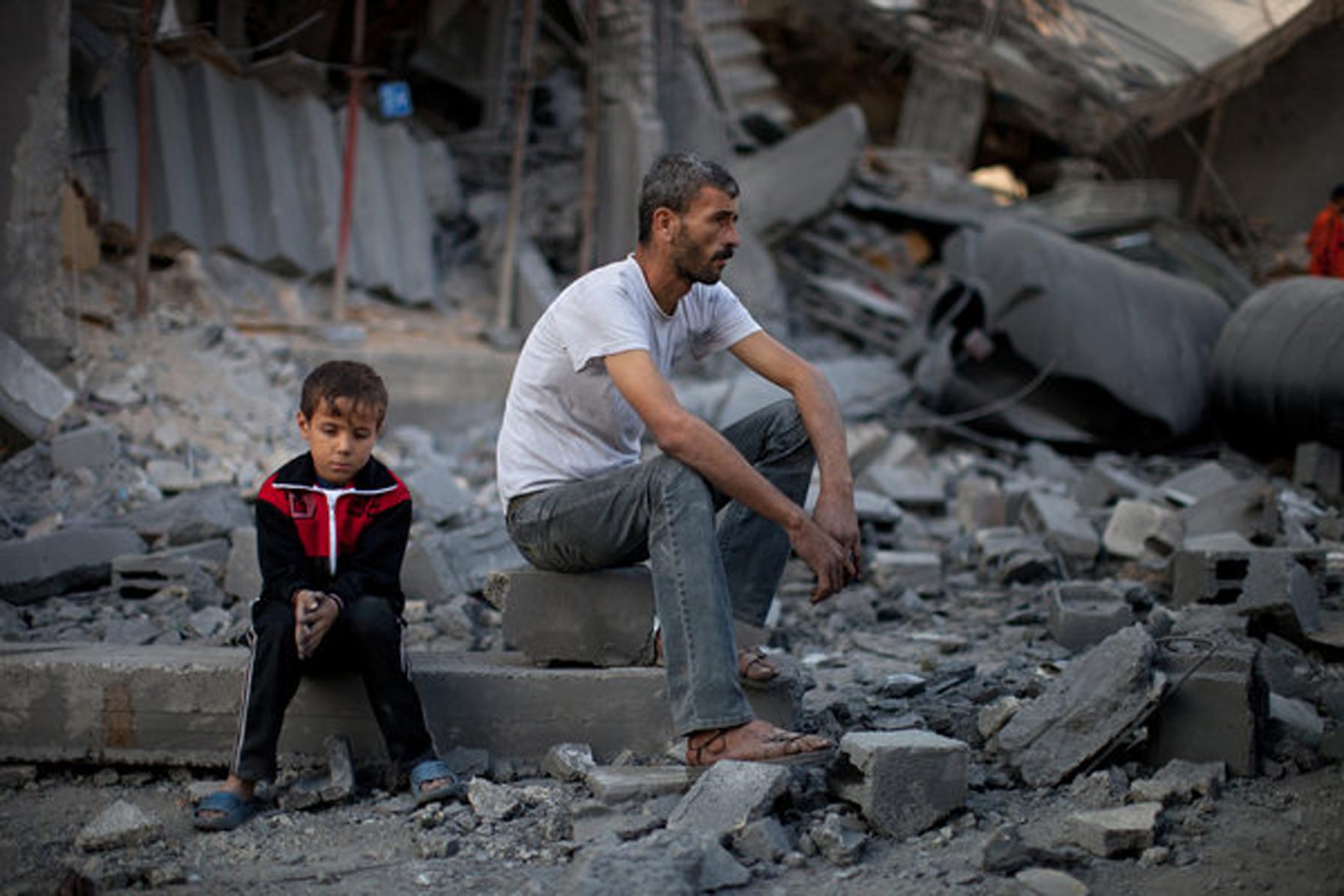 gaza man on rubble