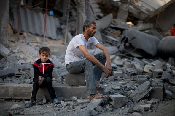 gaza man on rubble